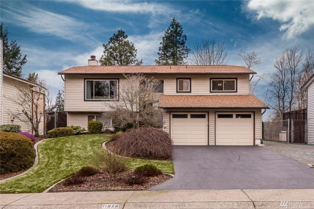 11626 SE 210th Place, Kent, WA 98031 (#1246682) :: Kwasi Bowie and Associates
