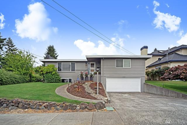 1223 S Geiger St, Tacoma, WA 98465 (#1260084) :: The Vija Group - Keller Williams Realty