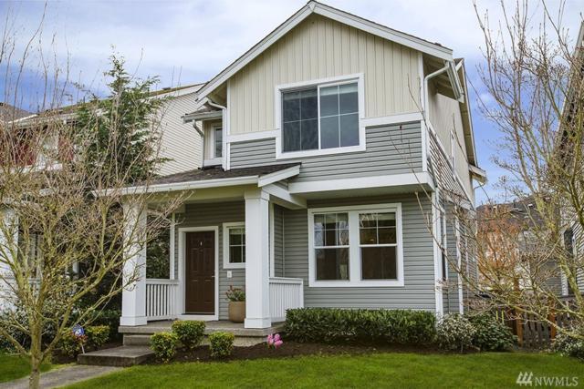 3011 SW Bataan St, Seattle, WA 98126 (#1274061) :: Carroll & Lions
