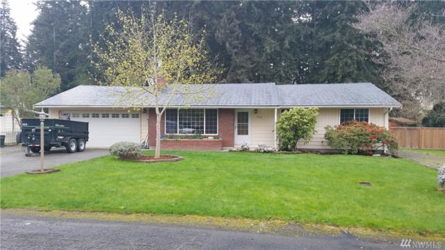 7406 48th Ave E, Tacoma, WA 98443 (#1276641) :: The Snow Group at Keller Williams Downtown Seattle