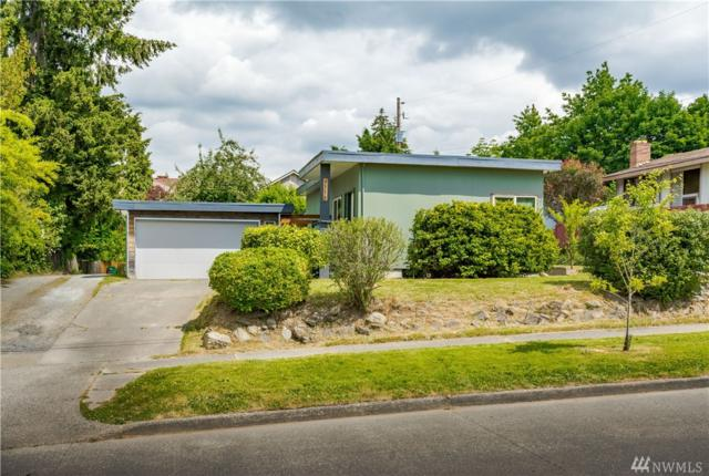 9712 57th Ave S, Seattle, WA 98118 (#1282561) :: Real Estate Solutions Group
