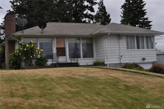 7522 Olympus Dr W, Tacoma, WA 98466 (#1285477) :: Kwasi Bowie and Associates