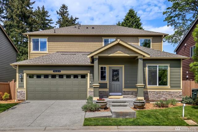 7624 NE 201st Place, Kenmore, WA 98028 (#1286116) :: McAuley Real Estate