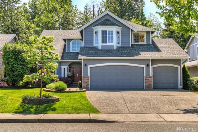 12719 SE 302nd St, Auburn, WA 98092 (#1288421) :: Morris Real Estate Group