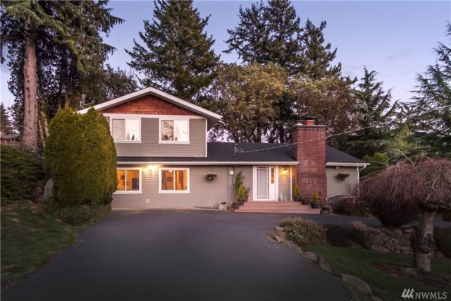 12018 21st Ave SW, Burien, WA 98146 (#1290995) :: Real Estate Solutions Group