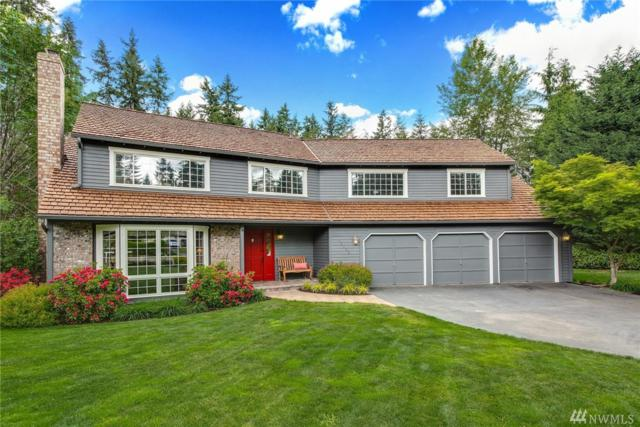 18124 NE 200th Ct, Woodinville, WA 98077 (#1292560) :: Real Estate Solutions Group