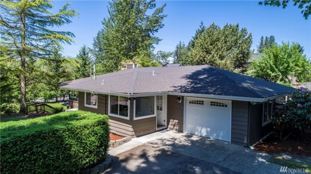 12410 NE 104th St, Kirkland, WA 98033 (#1292639) :: Kwasi Bowie and Associates