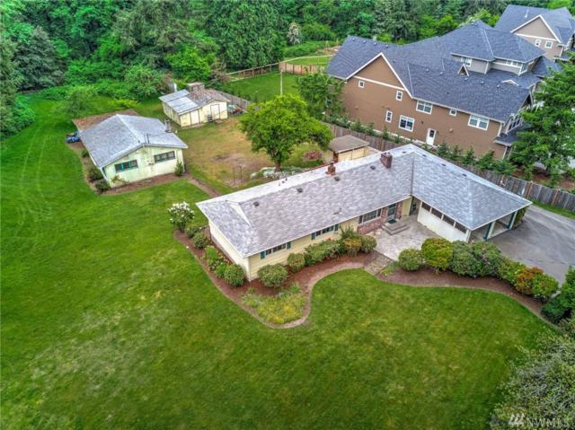 13905 SE May Valley Rd, Renton, WA 98059 (#1294571) :: Ben Kinney Real Estate Team
