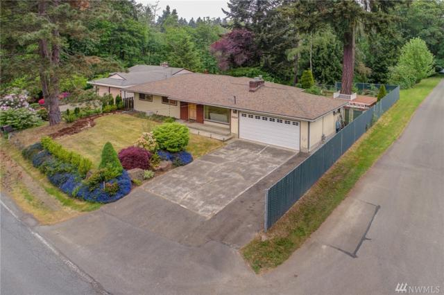12104 SE May Creek Park Dr, Newcastle, WA 98056 (#1295163) :: Kwasi Bowie and Associates