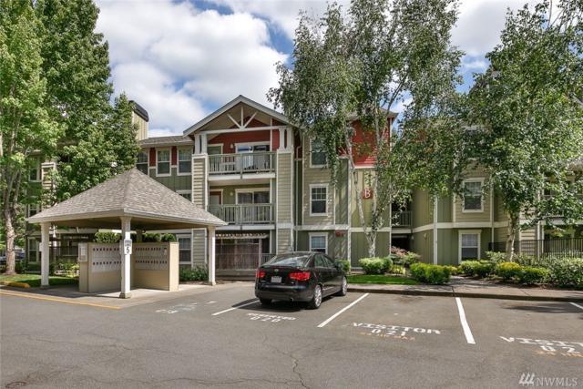 7711 NE 175th St B309, Kenmore, WA 98028 (#1295454) :: McAuley Real Estate