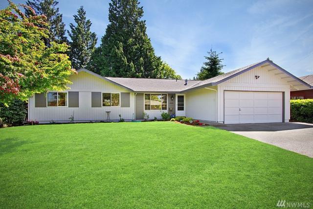 999 Tacoma Ave NE, Renton, WA 98056 (#1296810) :: Kwasi Bowie and Associates