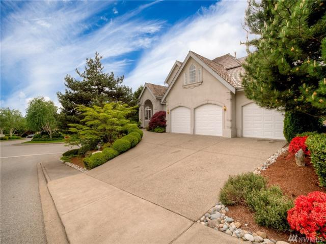 6293 155th Ave SE, Bellevue, WA 98006 (#1296815) :: Kwasi Bowie and Associates
