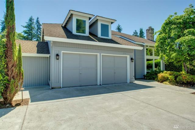 9529 NE 31st St, Clyde Hill, WA 98004 (#1297843) :: Homes on the Sound
