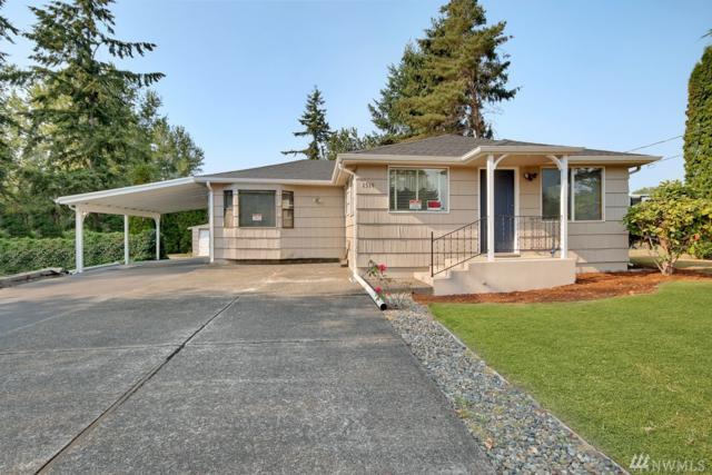 1519 90th St E, Tacoma, WA 98445 (#1298786) :: Keller Williams Everett