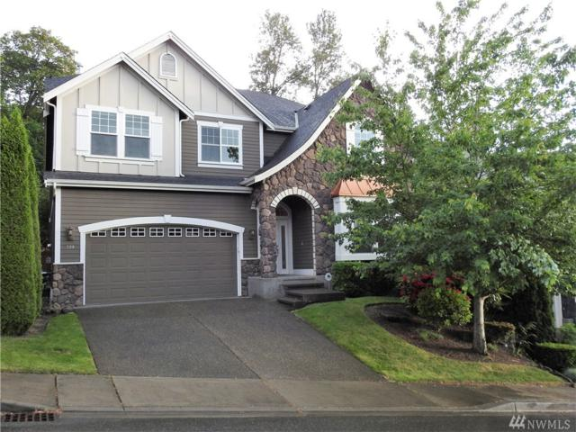 719 S 38th Ct, Renton, WA 98055 (#1301947) :: Real Estate Solutions Group