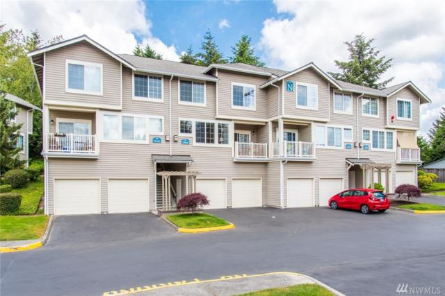18648 NE 57th Wy #18648, Redmond, WA 98052 (#1302270) :: Real Estate Solutions Group