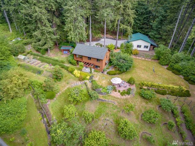 9279 Sands Ave NE, Bainbridge Island, WA 98110 (#1302471) :: Real Estate Solutions Group