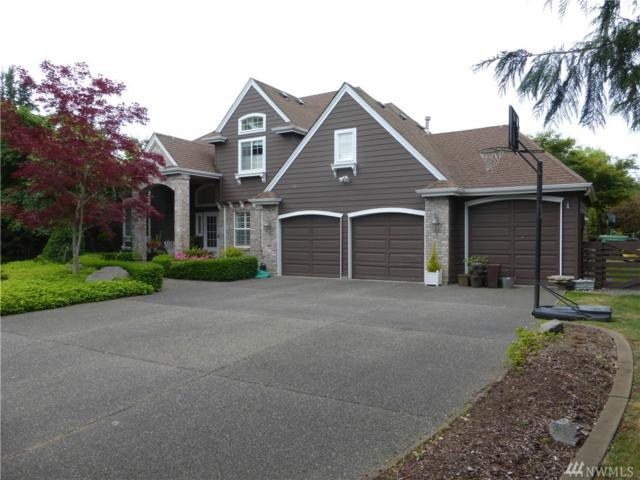 9428 72nd Ave NW, Gig Harbor, WA 98332 (#1304540) :: Real Estate Solutions Group