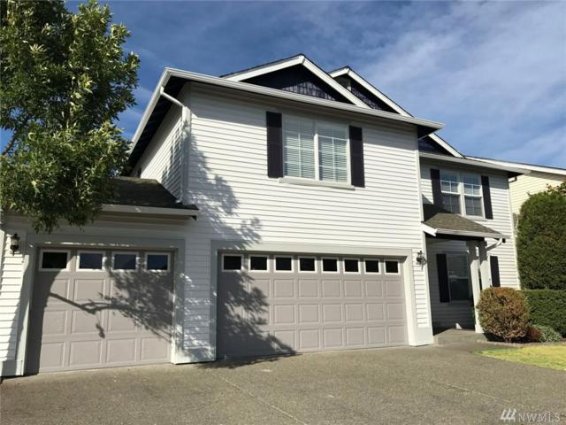 12618 SE 299th Place, Auburn, WA 98092 (#1304673) :: Real Estate Solutions Group
