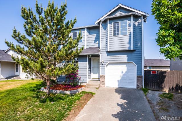 9037 S Sheridan Ave, Tacoma, WA 98444 (#1306804) :: Real Estate Solutions Group
