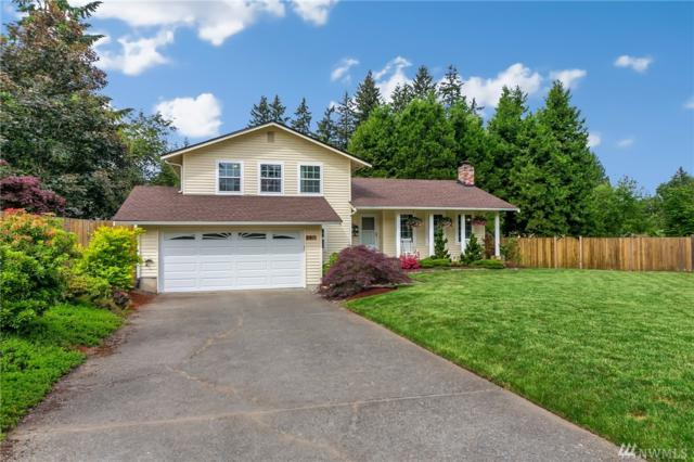 8911 NE 142nd Wy, Kirkland, WA 98034 (#1307124) :: Real Estate Solutions Group