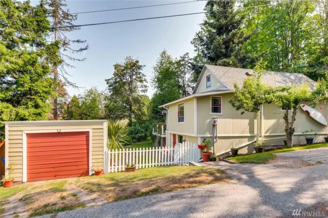 4159 22nd Ave SW, Seattle, WA 98106 (#1309145) :: Real Estate Solutions Group