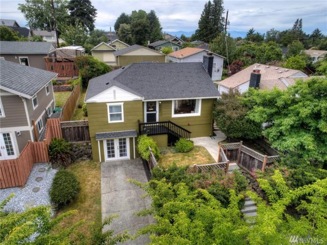 6031 37th Ave SW, Seattle, WA 98126 (#1309802) :: Real Estate Solutions Group