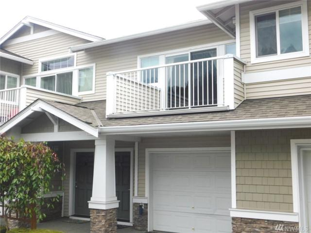 4049 S 212th Ct E, SeaTac, WA 98198 (#1310625) :: Real Estate Solutions Group