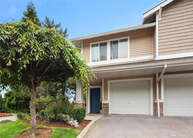 21920 42nd Ave S #201, Kent, WA 98032 (#1310744) :: Real Estate Solutions Group
