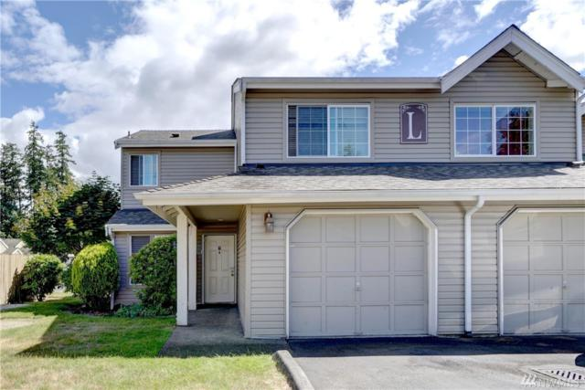 2100 S 336th St L1, Federal Way, WA 98003 (#1311933) :: Carroll & Lions