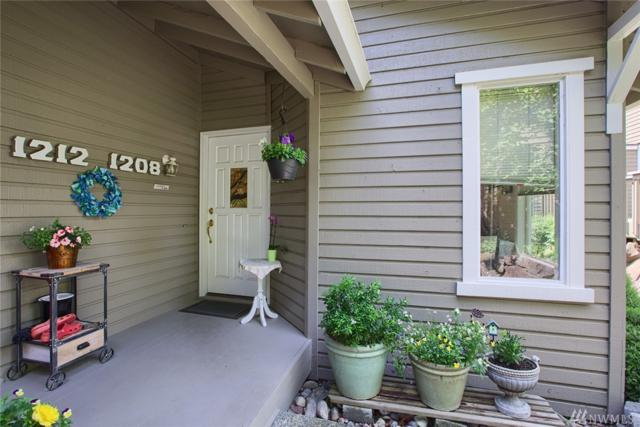 1208 100th Pl #1208, Bellevue, WA 98004 (#1315997) :: Costello Team