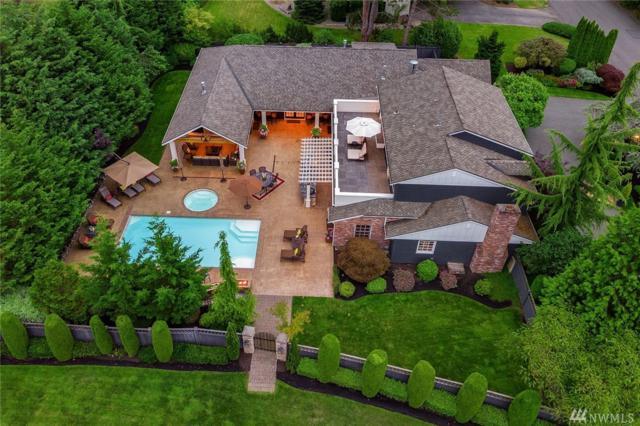 8504 NE 15th St, Clyde Hill, WA 98004 (#1318842) :: McAuley Real Estate