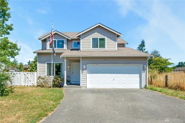 12211 2nd Av Ct E, Tacoma, WA 98445 (#1325547) :: Keller Williams Realty Greater Seattle