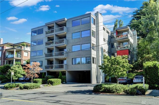 654 W Olympic Place #203, Seattle, WA 98119 (#1325759) :: Beach & Blvd Real Estate Group