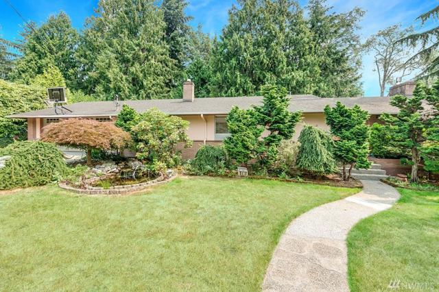 10818 11th Ave NE, Seattle, WA 98125 (#1326020) :: Carroll & Lions