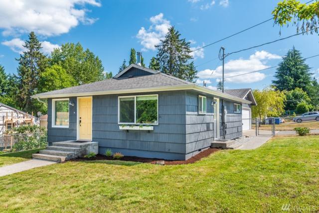 1202 E 54th St, Tacoma, WA 98404 (#1330209) :: NW Home Experts