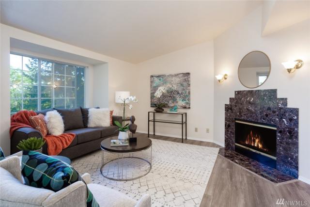 8653 Avondale Rd NE A302, Redmond, WA 98052 (#1335393) :: McAuley Real Estate