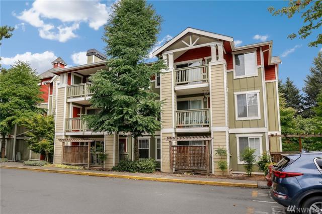 7711 NE 175th St F105, Kenmore, WA 98028 (#1342406) :: McAuley Real Estate