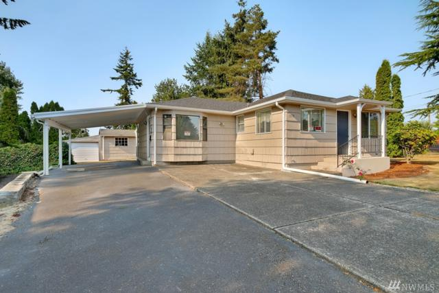 1519 90th St E, Tacoma, WA 98445 (#1342602) :: Keller Williams Everett