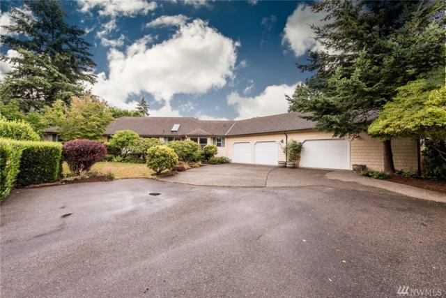 10911 NE 62nd Street, Kirkland, WA 98033 (#1343407) :: The DiBello Real Estate Group