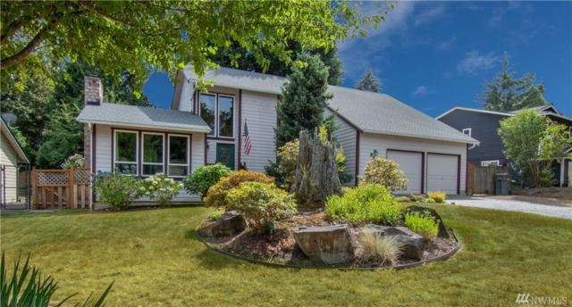 9013 NE 143 St, Kirkland, WA 98034 (#1345299) :: Homes on the Sound