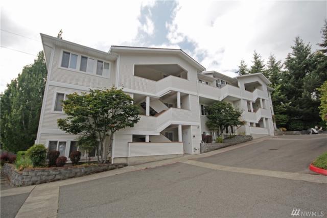 12406 SE 31st St #203, Bellevue, WA 98005 (#1345392) :: Carroll & Lions