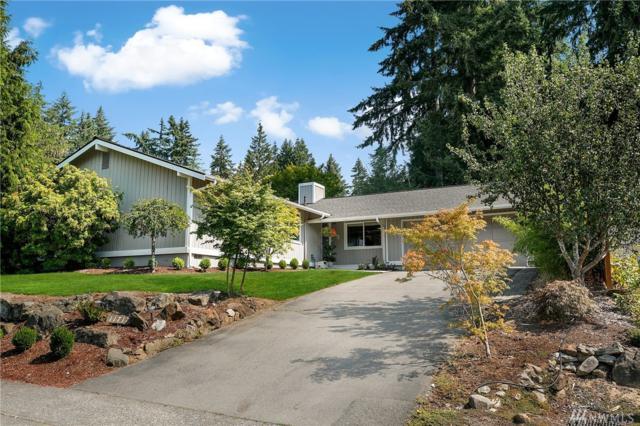 11717 NE 144th Place, Kirkland, WA 98034 (#1345461) :: Icon Real Estate Group