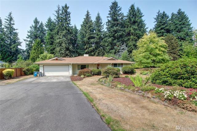 10004 SE 267th St, Kent, WA 98030 (#1346170) :: Homes on the Sound