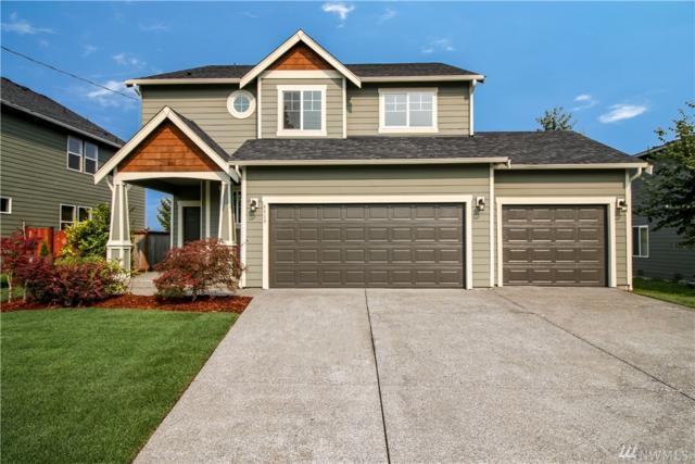 8519 Mckinley Ave E, Tacoma, WA 98445 (#1346545) :: Keller Williams Everett