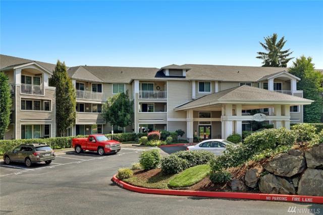 2244 132nd Ave SE B214, Bellevue, WA 98005 (#1349143) :: Carroll & Lions