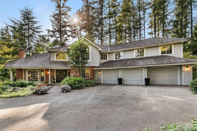 18328 NE 199th Place, Woodinville, WA 98077 (#1353937) :: Homes on the Sound