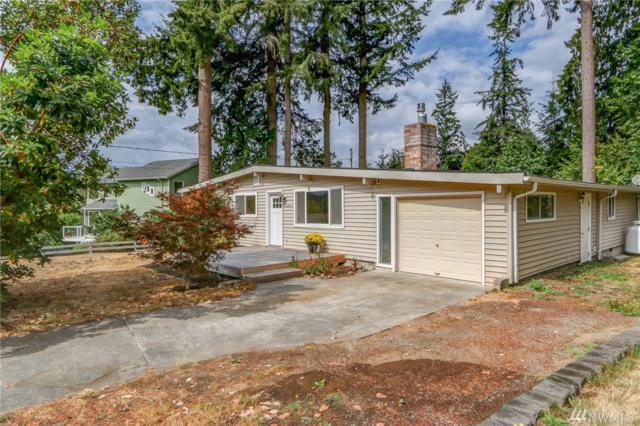 7260 NE Beach Ave, Poulsbo, WA 98370 (#1353996) :: Homes on the Sound