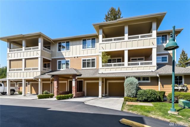 23916 NE 115th Lane 304-2, Redmond, WA 98053 (#1354590) :: Homes on the Sound