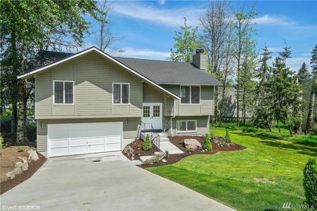 8034 NE 28th St, Hunts Point, WA 98004 (#1358638) :: Homes on the Sound